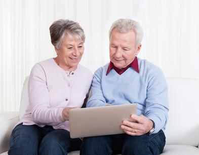 Senior couple looking at laptop computer